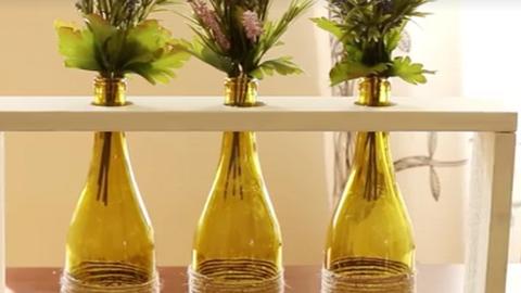 DIY őszi dekoráció: gyönyörű asztaldísz borosüvegekből