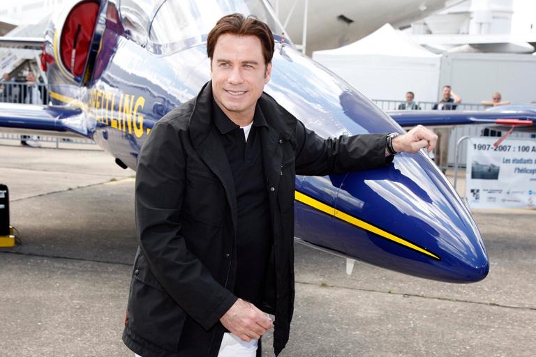 Travolta egy repülőgépkiállításon (Fotó: Profimedia)