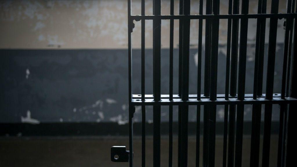 börtön rács cella
