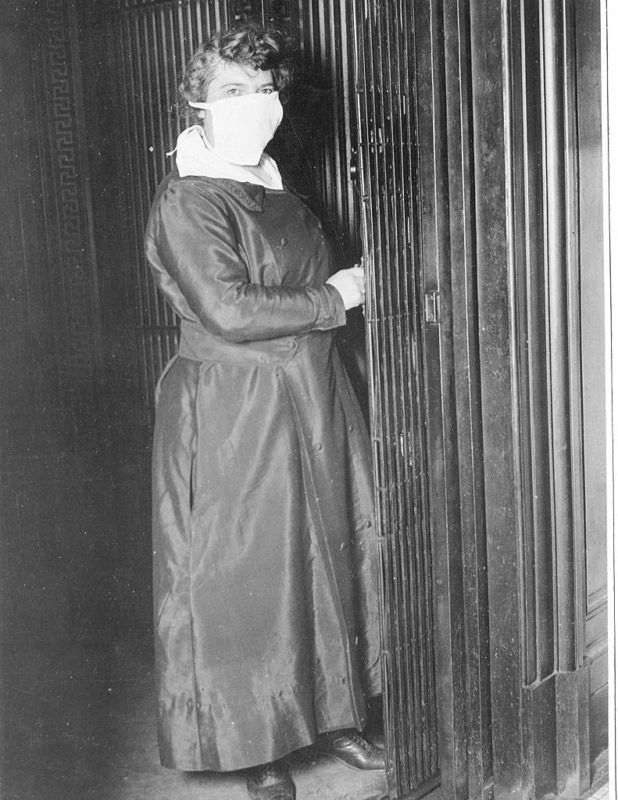 Female Elevator operator in New York City, NY, wearing a mask to protect against Spanish flu, New York, October 16, 1918. (Photo by PhotoQuest/Getty Images)