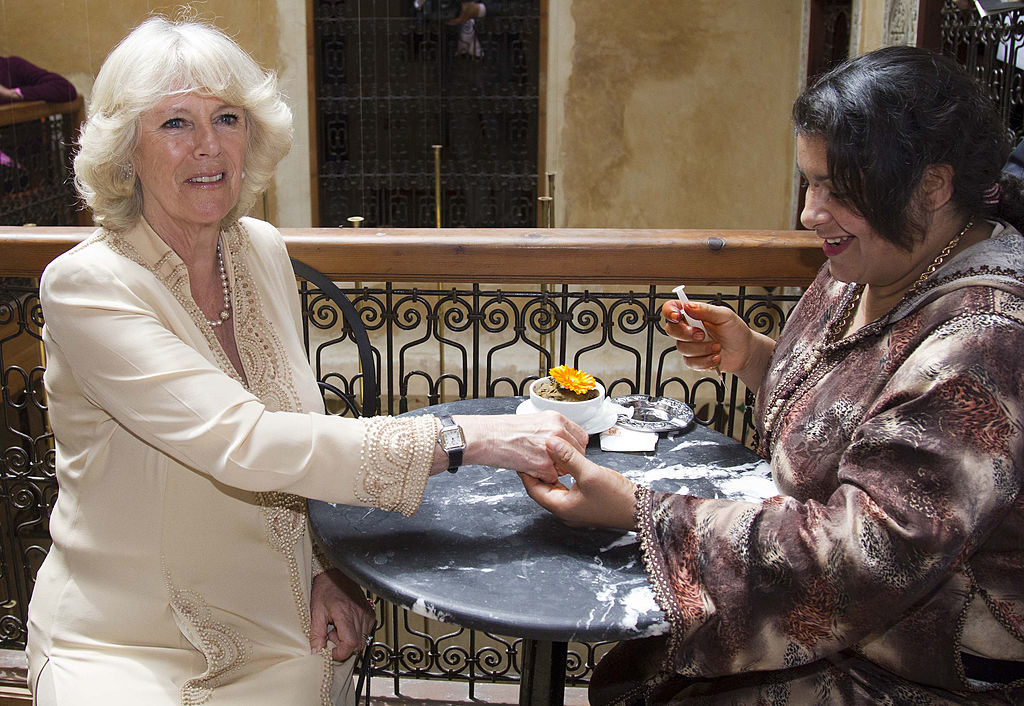 FEZ, MOROCCO - APRIL 06: (NO UK SALES FOR 28 DAYS) Camilla, Duchess of Cornwall is given a henna tattoo as she visits Clock Cafe in the Medina on day three of a three day visit to Morocco on April 6, 2011 in Fez, Morocco. (Photo by Samir Hussein/WireImage)