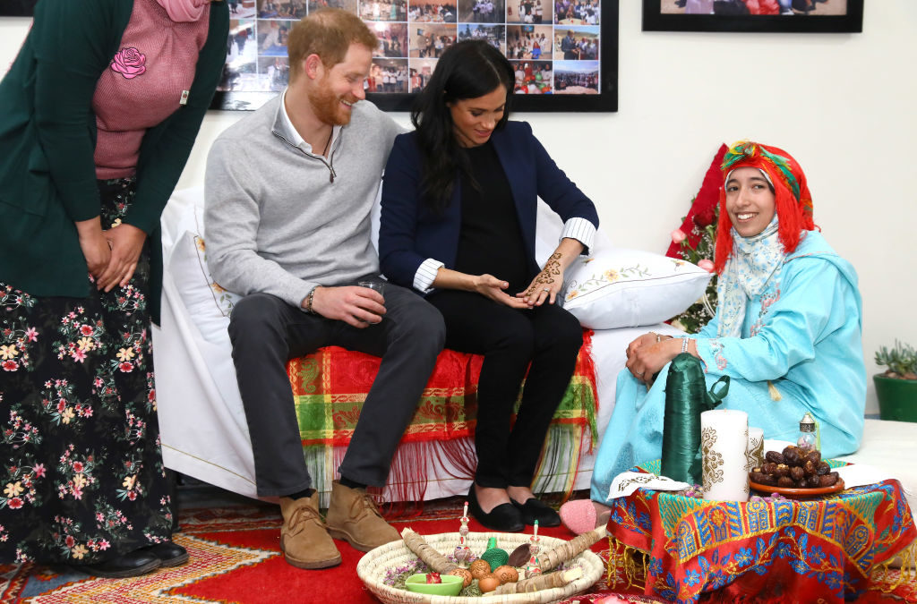 """ASNI, MOROCCO - FEBRUARY 24: Prince Harry, Duke of Sussex and Meghan, Duchess of Sussex during a Henna ceremony as they visit the """"Education For All"""" boarding house for girls aged 12 to 18 on February 24, 2019 in Asni, Morocco. """"Education For All"""" ensures that girls from rural communities in the High Atlas Mountain regions have access to secondary education. (Photo by Tim P. Whitby - Pool/Getty Images)"""