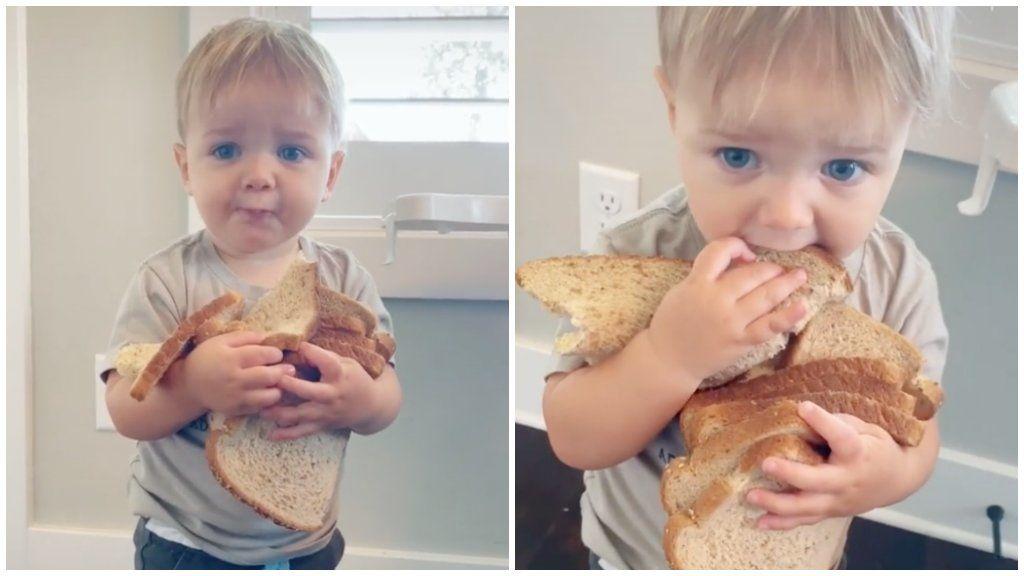 Kisfiú sok szelet kenyérrel