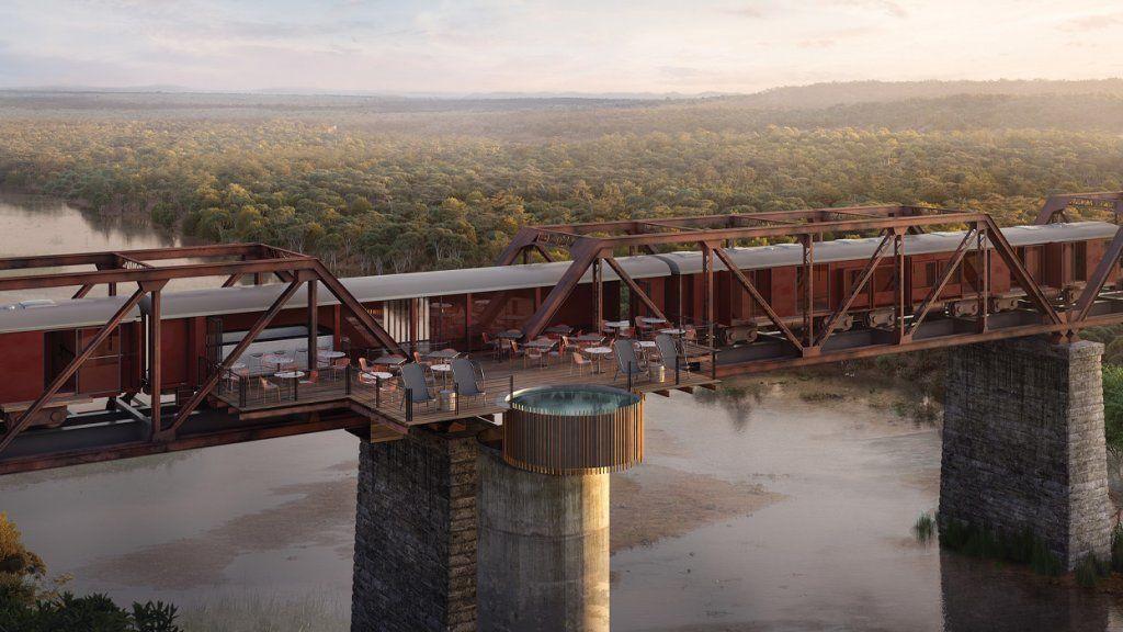 Luxushotel a hídon álló vonatból