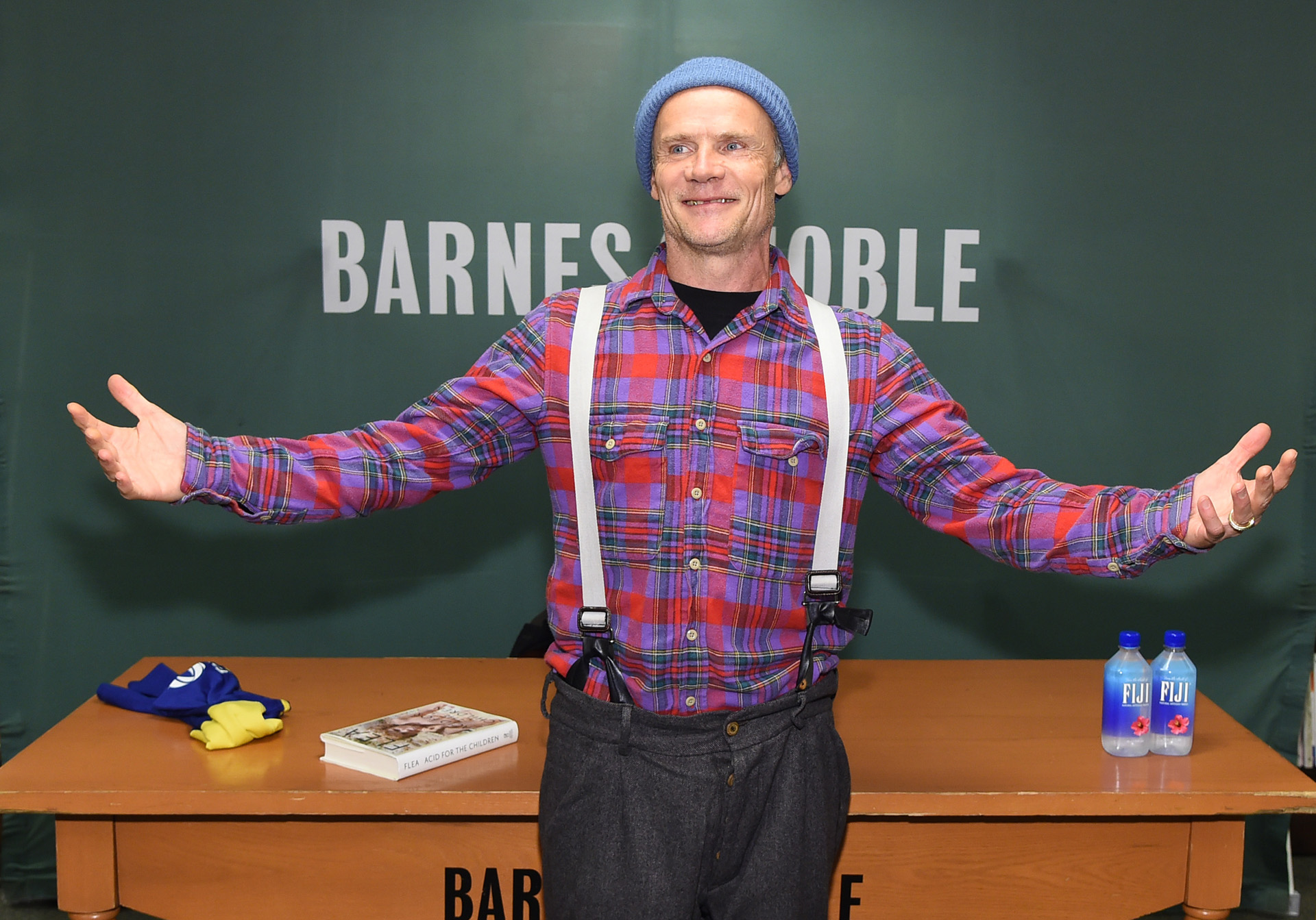 """NEW YORK, NEW YORK - NOVEMBER 05: Flea of the Red Hot Chili Peppers signs copies of his new book """"Acid For The Children"""" at Barnes & Noble, 5th Avenue on November 05, 2019 in New York City. Jamie McCarthy/Getty Images/AFP"""