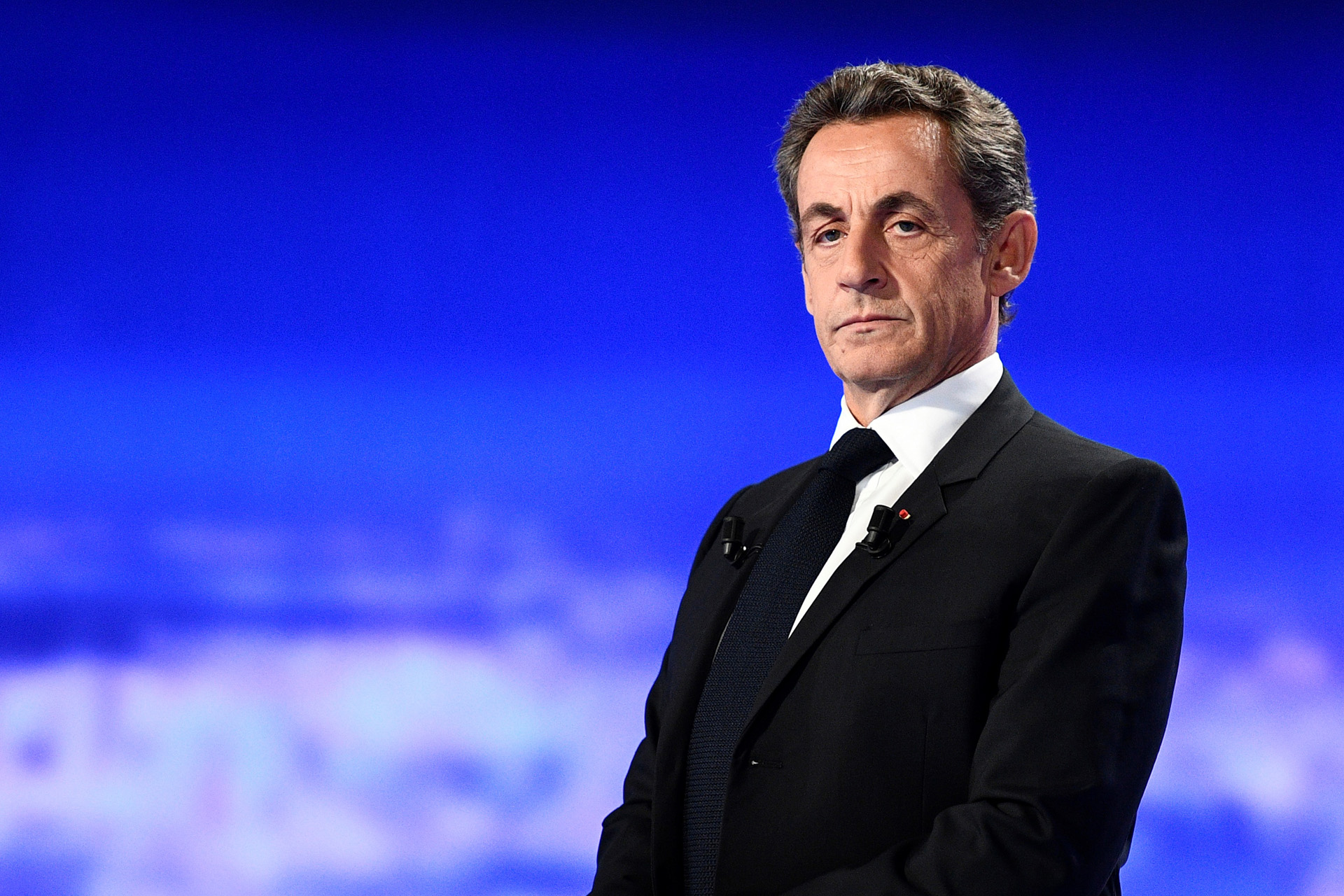 (FILES) In this file photo taken on October 13, 2016 Former French President and candidate for the right-wing Les Republicains (LR) party primaries Nicolas Sarkozy takes part in the first televised debate between the seven candidates for France's right-wing presidential nomination ahead of the 2017 presidential election, at the studios of French private television channel TF1 in La Plaine-Saint-Denis, north of Paris. - The Paris Court of Appeal is set to deliberate on September 24, 2020 on the appeals for nullity filed, among others, by Nicolas Sarkozy, Claude Gueant and businessman Alexandre Djouhri, against the investigation into suspicions of Libyan financing by the candidate of the right in the 2007 presidential campaign. (Photo by Martin BUREAU / various sources / AFP)